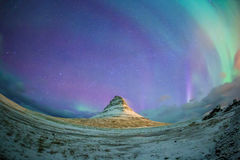 Spectacular northern lights appear over Mount Kirkjufell Royalty Free Stock Photos