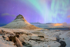 Spectacular northern lights appear over Mount Kirkjufell royalty free stock photography