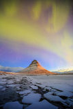 Spectacular northern lights appear over Mount Kirkjufell Stock Images