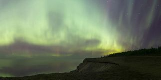 Spectacular Northern Lights Panorama. Colorful Aurora panorama from Saaremaa Estonia. Colors are real and so bright that the water has nice reflections Stock Photography