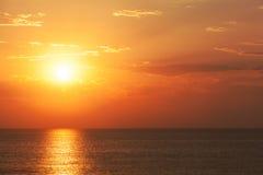 Spectacular orange tropical sunset Stock Photos