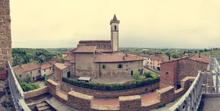 Spectacular panoramic view of church rising above medieval town. stock image
