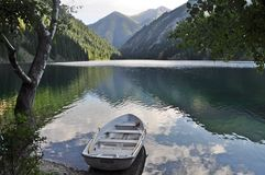 Spectacular Peaceful mountainscape with boat Stock Images