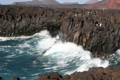 People at volcanic rocks above the ocean,Lanzarote Stock Image