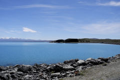 Spectacular quiet Lake alpine cold water: New Zealand Lake Tekapo Stock Photography