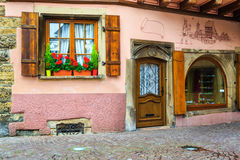 Spectacular retro house with colorful fresh flowers on the corner Royalty Free Stock Photos