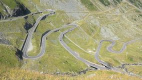 Spectacular road in the mountains, drive on Tranfagarasan highway Romania. UHD 4K stock footage