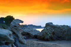 Spectacular roaring scale lion sunrise. Spectacular beach sunrise,scale in the form of a roaring lion from whose mouth comes flame ,Chalkidiki Greece Royalty Free Stock Photo
