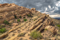 Spectacular Rock Formation at Vazquez Rocks. Spectacular formation with dramatic storm sky at Vazquez Rocks in Southern California Royalty Free Stock Photo