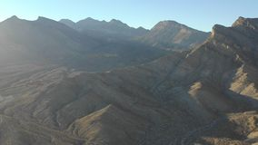 Aerial of mountains near Las Vegas, Nevada. Spectacular rock formations are found in Red Rock Canyon State Park just outside of Las Vegas, Nevada. This stock footage