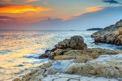 Spectacular rocky beach and beautiful sunset near Rovinj,Istria,Croatia Royalty Free Stock Photos