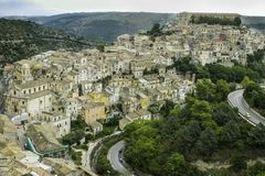 Spectacular scenic view of colorful houses in old Ragusa Ibla and a winding road in Sicily. Spectacular scenic view of colorful houses and a winding road in old royalty free stock image