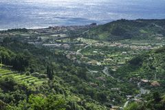 Spectacular scenic view of Santa Teresa di Riva and the blue ionean sea from the hills in Sicily. Spectacular scenic view of Santa Teresa di Riva and the blue stock image