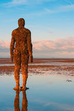 Spectacular sculptures are on Crosby beach. Royalty Free Stock Image