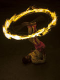 A spectacular site as a Fire Ball Dancer performs along a street in Kandy during the Esala Perahera great procession in Sri Lanka. Royalty Free Stock Images