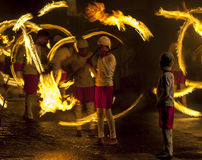 A spectacular site as Fire Ball Dancers perform along a street in Kandy during the Esala Perahera great procession in Sri Lanka. Stock Image