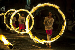 A spectacular site as Fire Ball Dancers perform along a street in Kandy during the Esala Perahera in Sri Lanka. Stock Photo