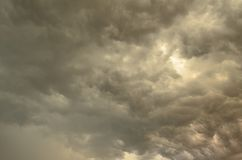 Spectacular stormy clouds. Wide view of spectacular ominous summer storm clouds stock image