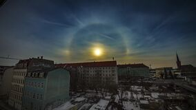 Spectacular Sun Halo Weather Timelapse Over A City 4K. A sun halo captured over dresden germany within a housing development stock video footage