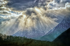 Spectacular sun rays  over french alps Royalty Free Stock Image