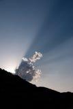 Spectacular sunbeams from clouds Stock Photos