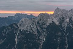 Spectacular sunrise line behind a mountain ridge. Royalty Free Stock Images
