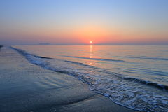 A spectacular sunrise over the sea. A spectacular sunrise over sea at the beginning of a day Stock Photos