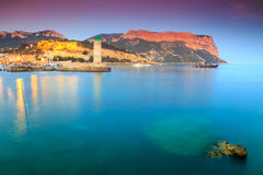 Spectacular sunset with Cassis lighthouse and Cap Canaille cliffs,France,Europe Stock Image