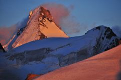 Spectacular Sunset on the Dent D'Herens. Vivid colours of the Dent d'Herens (4171m) and the Mont Mines glacier Royalty Free Stock Photography