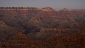 Spectacular sunset light over the layered rock, formed in million of years, observed at Grand Canyon National Park. Horizontal shot of landscape of American Royalty Free Stock Images