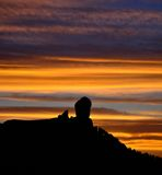 Silhouette of Roque Nublo on bright sky at nightfall, Gran canaria island. Sunset on Roque Nublo, Gran canaria, Canary islands Stock Images