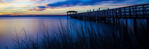 Spectacular sunset at the ocean pier stock photo