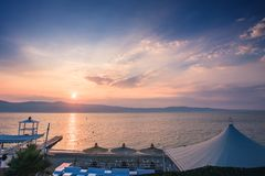 Spectacular sunset over Messina strait view from Reggio Calabria royalty free stock image