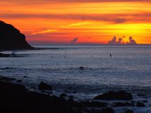 Spectacular sunset over rocky surfbeach Royalty Free Stock Photos