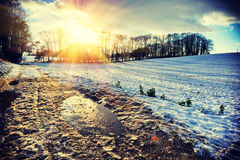 Spectacular sunset over snow covered field. Nature background Stock Photos