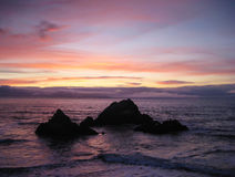 Spectacular sunset at Point Lobos looking out at Seal Rocks, San Royalty Free Stock Photos