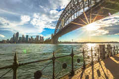 Sydney Harbour Bridge. Spectacular Sydney Skyline at sunset. Walking on the path that leads beneath the Sydney Harbour Bridge, New South Wales, Australia Stock Images