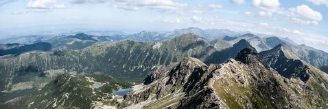 Spectacular Tatra mountains panorama from Hruba Kopa peak in Western Tatras mountains in Slovakia. With many peaks, few lakes and blue sky with clouds stock photos