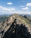 Spectacular Tatra mountains panorama from sharp ridge between Banikov and Hruba kopa mountain peaks on Rohace mountain group in. Spectacular Tatra mountains stock image