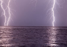 Spectacular thunders on striking the sea Stock Photo