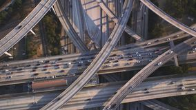 Spectacular top aerial drone panorama flight over busy highway multiple vehicle road with traffic cement junction bridge. Fascinating top aerial drone panorama stock footage