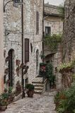 Spectacular traditional italian medieval alley in the historic center of beautiful little town of Spello Perugia Stock Image