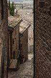 Spectacular traditional italian medieval alley in the historic center of beautiful little town of Spello Perugia Stock Photos