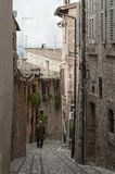 Spectacular traditional italian medieval alley in the historic center of beautiful little town of Spello Royalty Free Stock Images