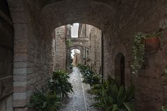 Spectacular traditional italian medieval alley in the historic center of beautiful little town of Spello Stock Photos
