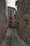 Spectacular traditional italian medieval alley in the historic center of beautiful little town of Spello Royalty Free Stock Photography