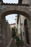 Spectacular traditional italian medieval alley in the historic center of beautiful little town of Spello Stock Images
