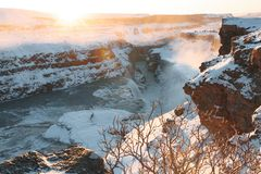 spectacular view of beautiful Gullfoss waterfall and snow-covered rocks stock images