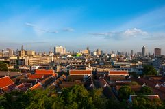 High view on Bangkok under blue sky with white clouds. Spectacular view on the capital city of Thailand, under clear blue sky and small white clouds, private Stock Photos