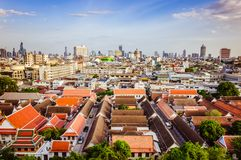 High view on Bangkok under blue sky with white clouds. Spectacular view on the capital city of Thailand, under clear blue sky and small white clouds, private Stock Image